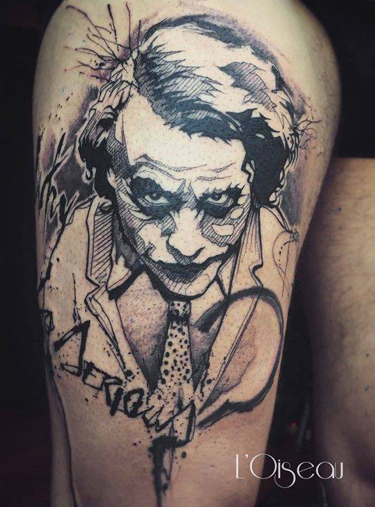Sketch work Joker tattoo on the right thigh.