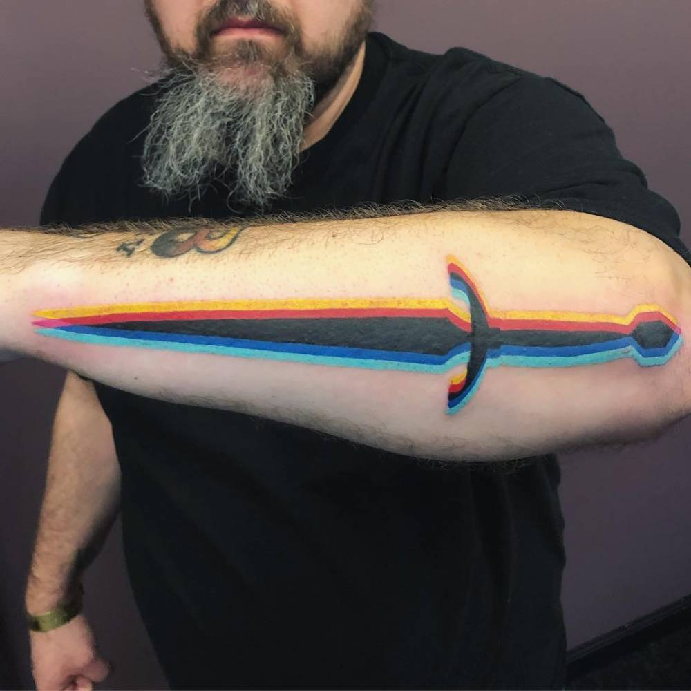 Dagger anaglyph tattoo on the forearm