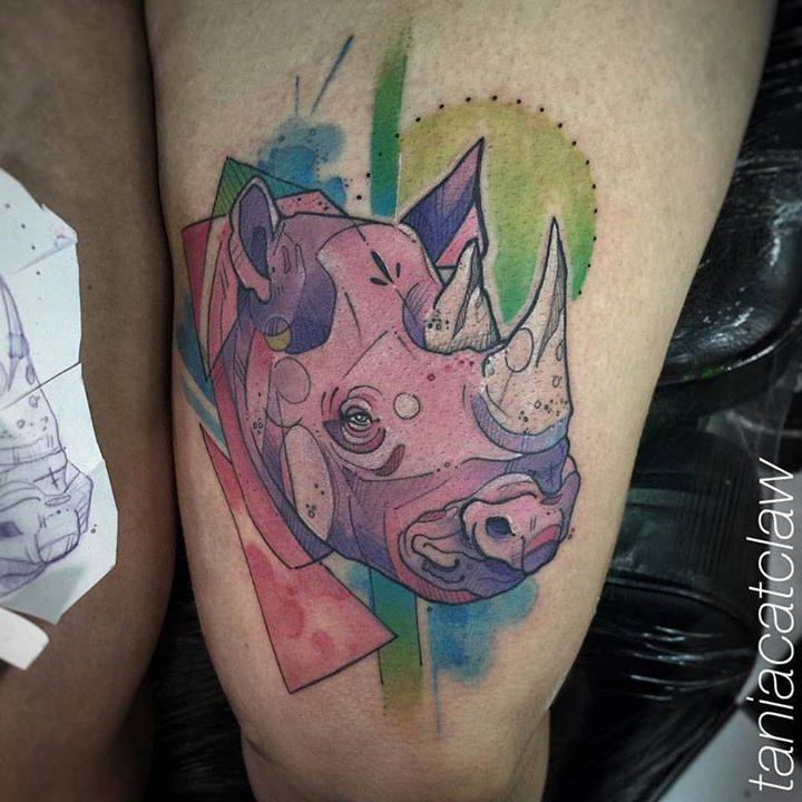 Sketch work rhino tattoo on the thigh.
