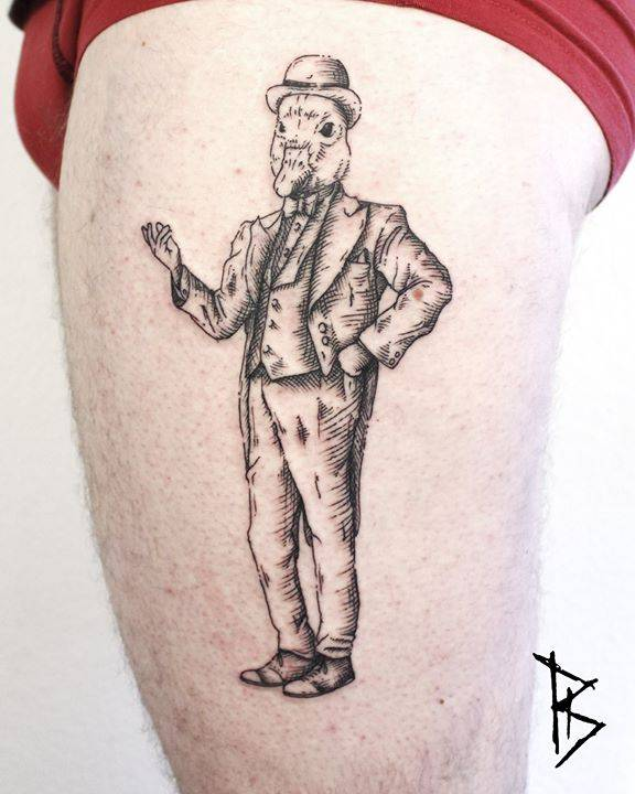 Dandy duck tattoo on the left thigh.