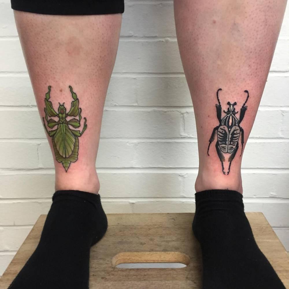 Matching bug tattoos.