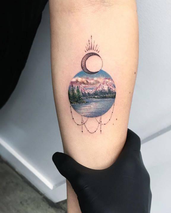 Landscape tattoo on the left inner forearm.