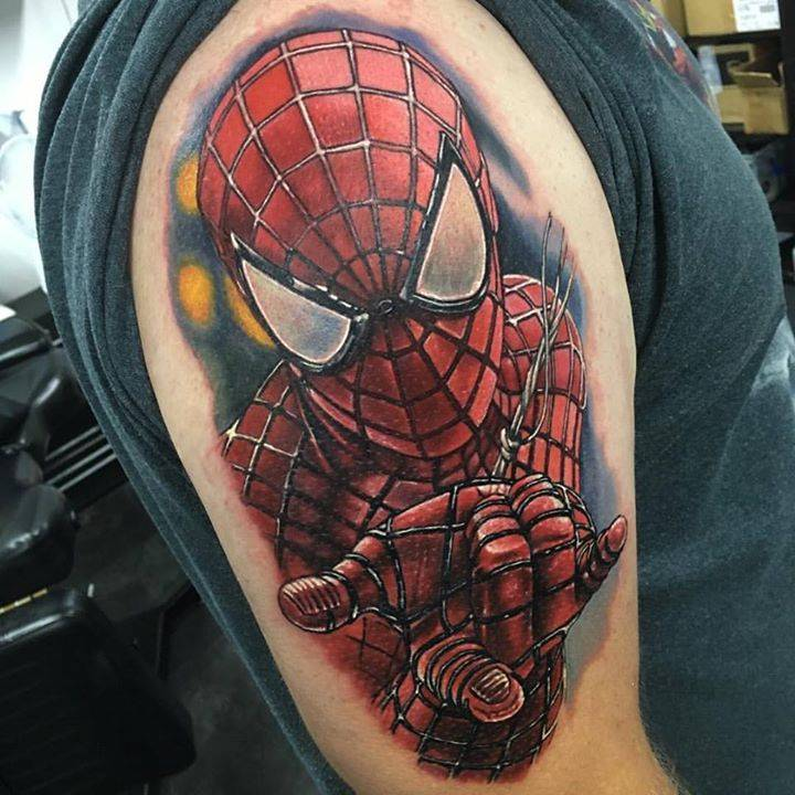 Realistic Spiderman tattoo on the right upper arm.