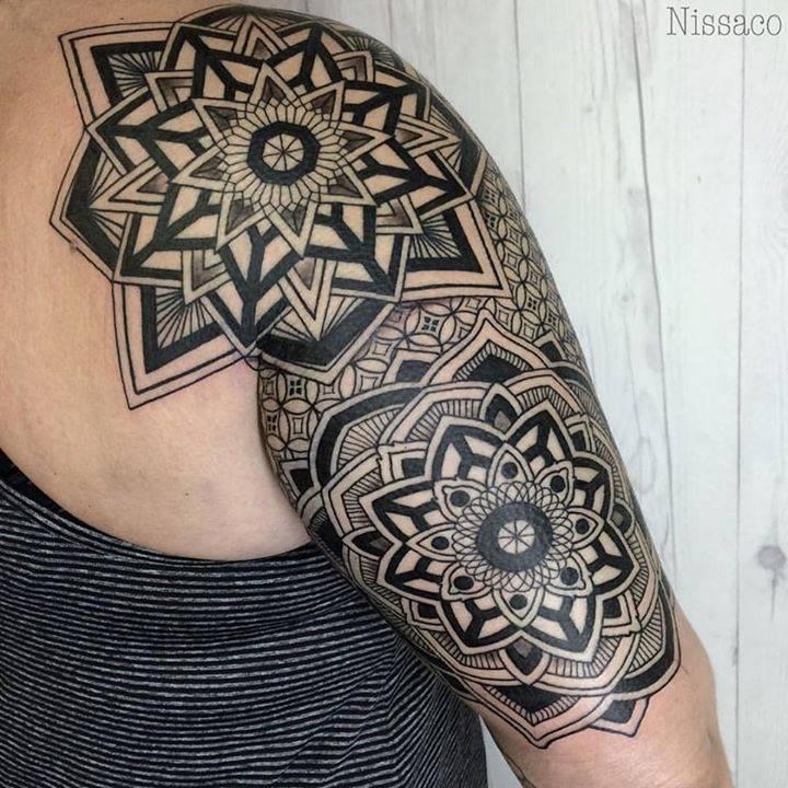 Mandala tattoos in progress to back piece.