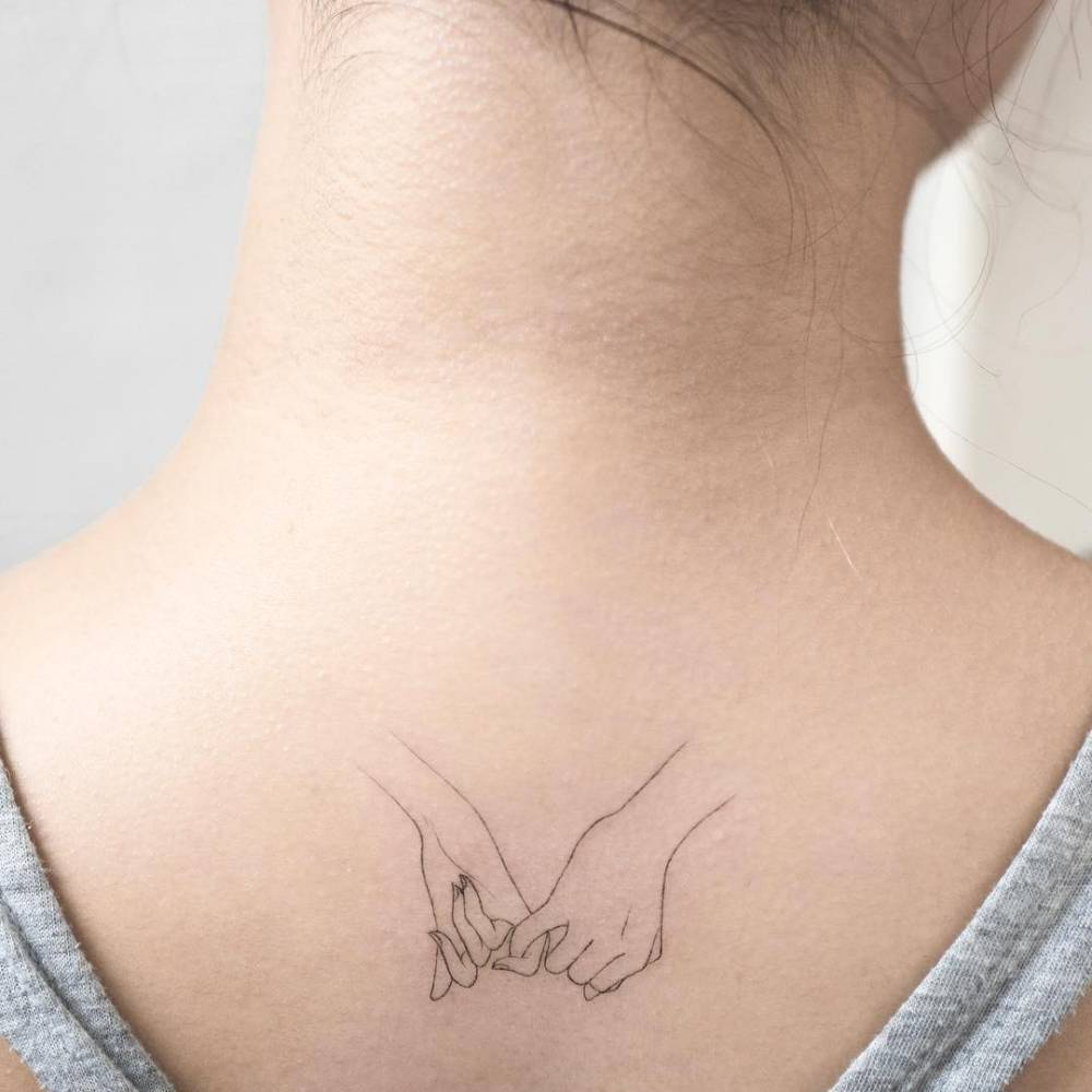Pinky Promise Tattoo On The Upper Back
