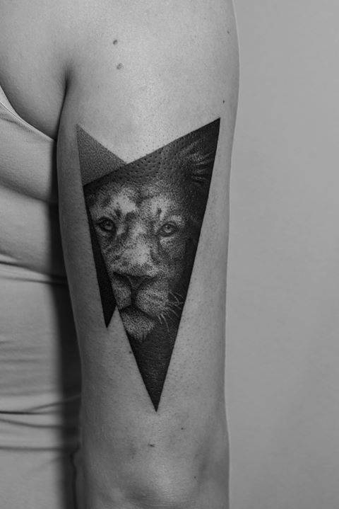 Dotwork Style Lion Tattoo On The Back Of The Right Arm
