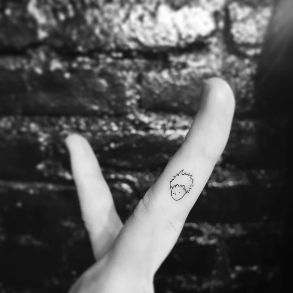 The Little Prince tattoo on the finger.