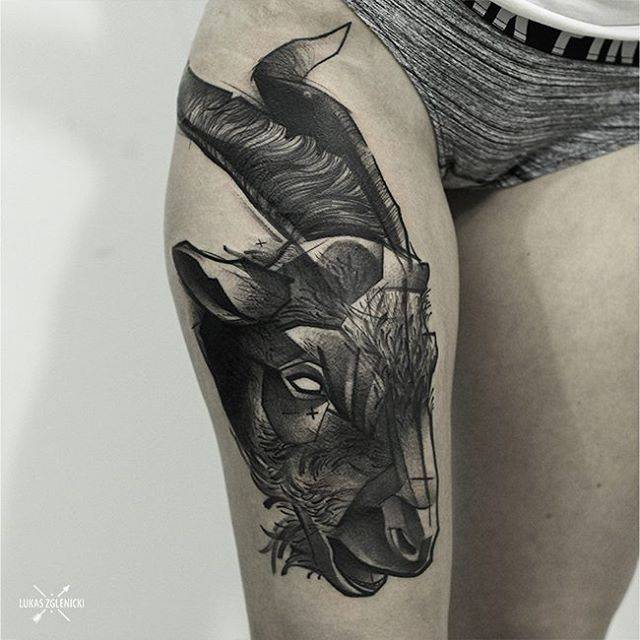 Sketch work goat tattoo on the right thigh.