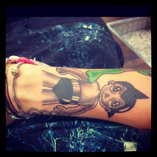 Astro boy tattoo on Ruby Rose's forearm.
