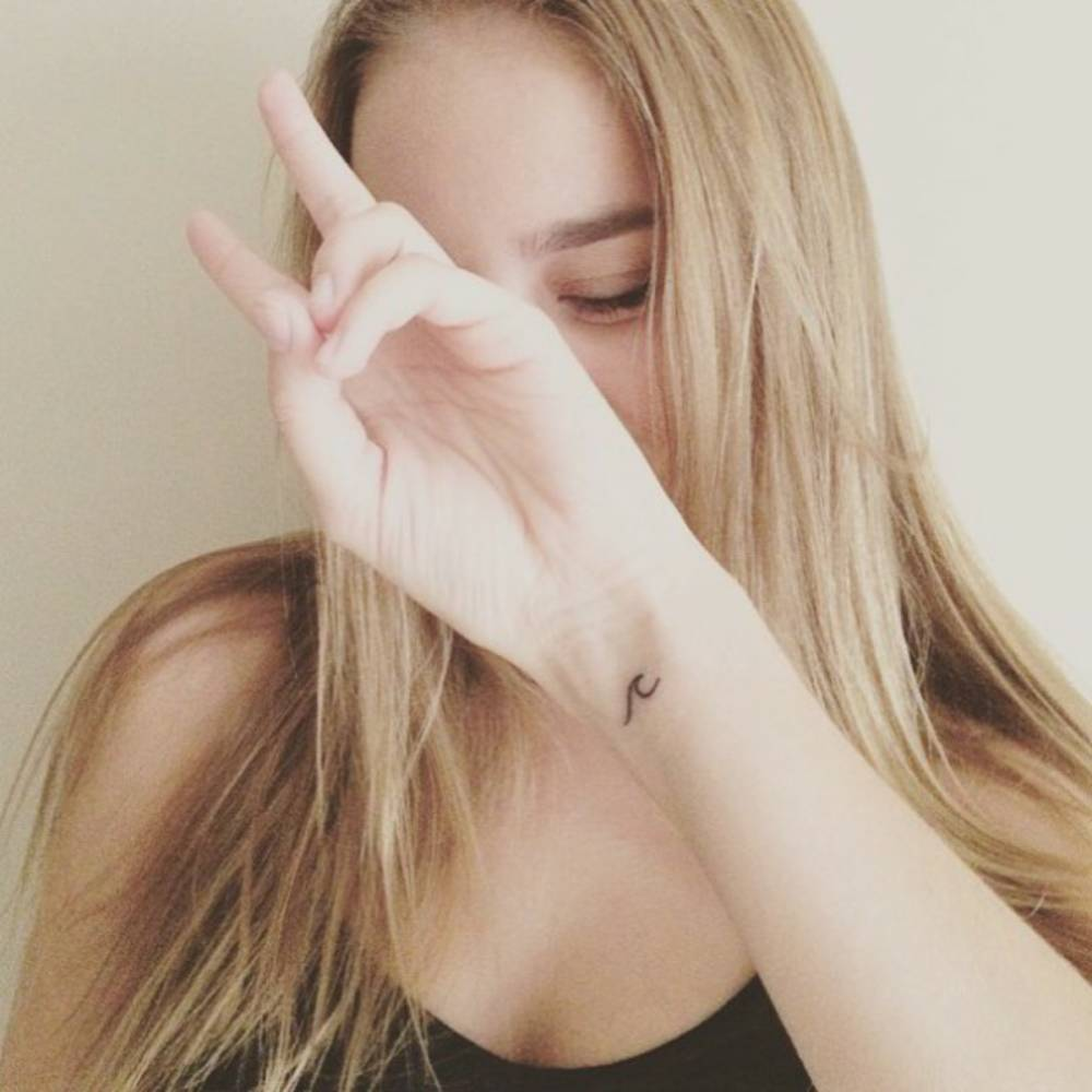 Tiny Wave Tattoo On Kailyn Phillips Wrist