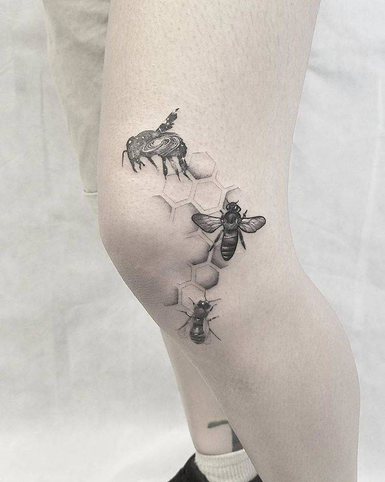 Single needle bee tattoos on the left knee.