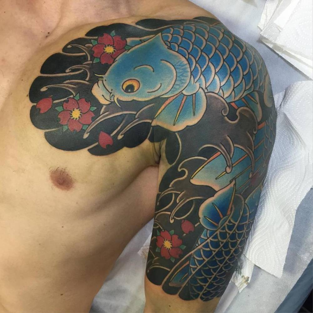Koi Fish Chest Plate Tattoo Covering Scar: Japanese Style Koi Fish Tattoo On The Left Upper Arm