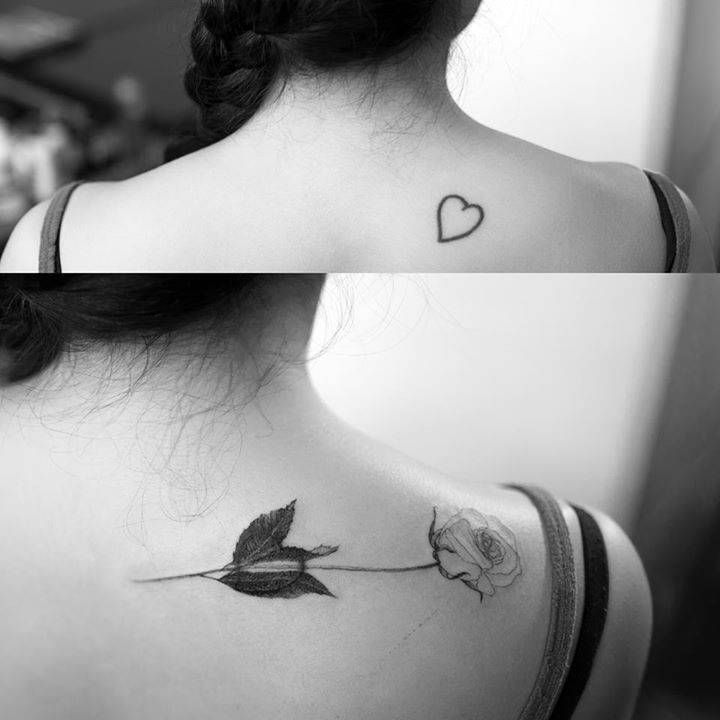 White rose tattoo covering a heart tattoo.