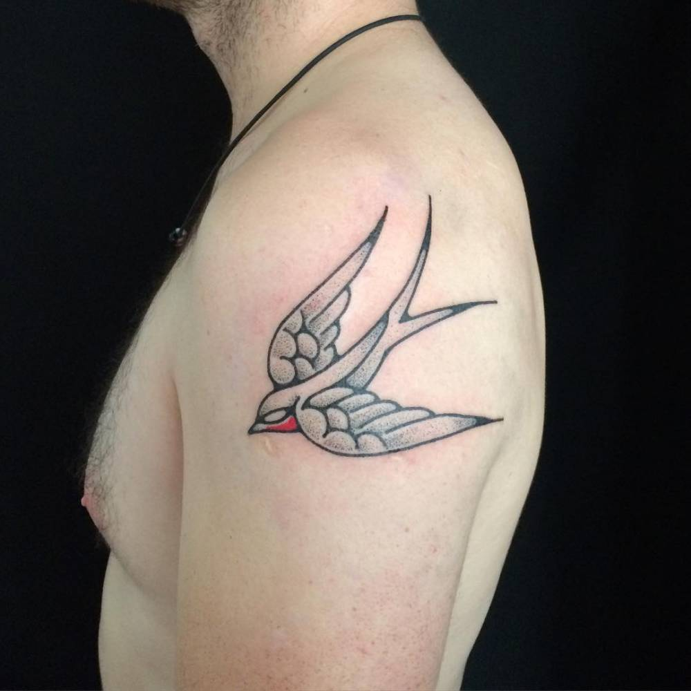 Hand poked swallow tattoo on the left upper arm for Swallow hand tattoo