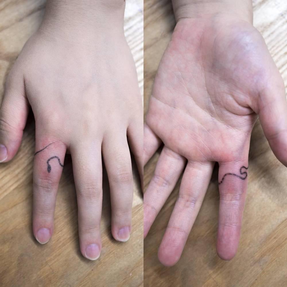 Hand poked snake tattoo on the finger for Animal finger tattoos