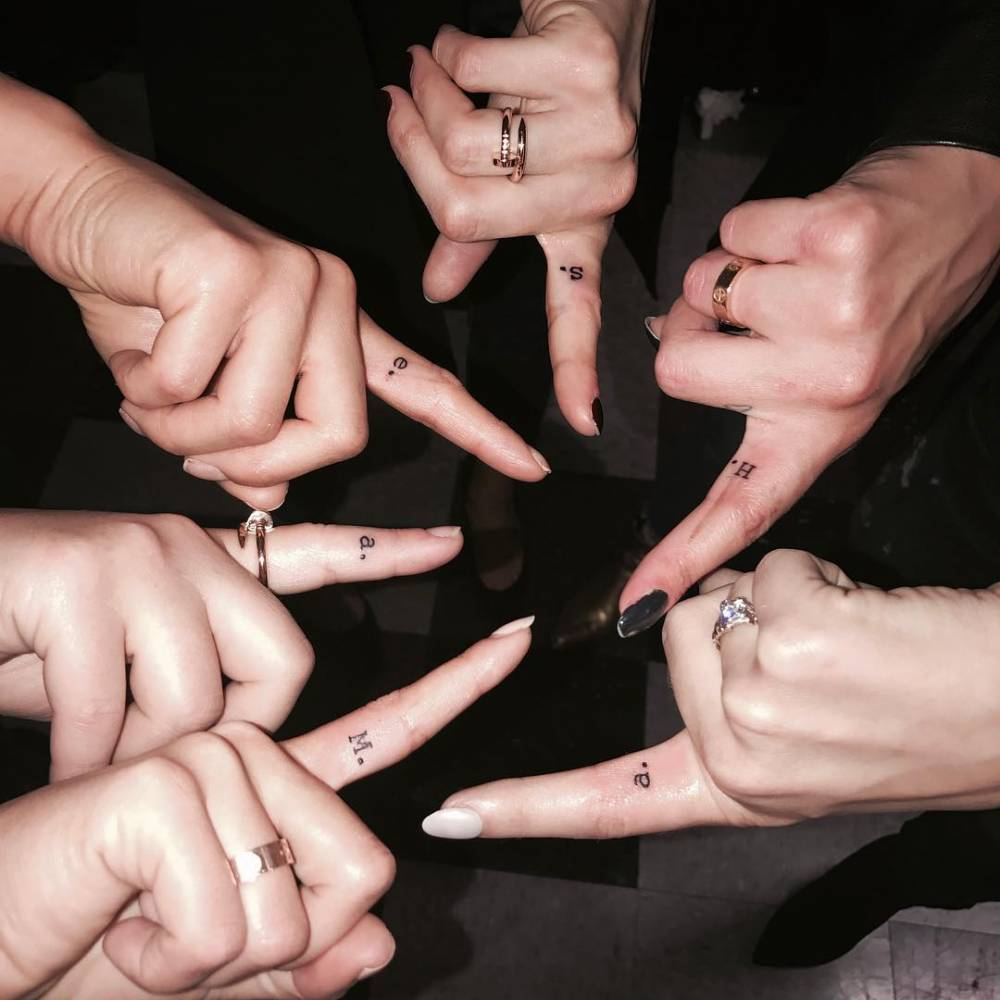 "The cast of 'Pretty Little Liars' (Lucy Hale, Janel Parrish, Sasha Pieterse, Shay Mitchell, Troian Bellisario and Ashley Benson) got the first initial of her character's name tattooed on their ""Shhhhhh"" finger."