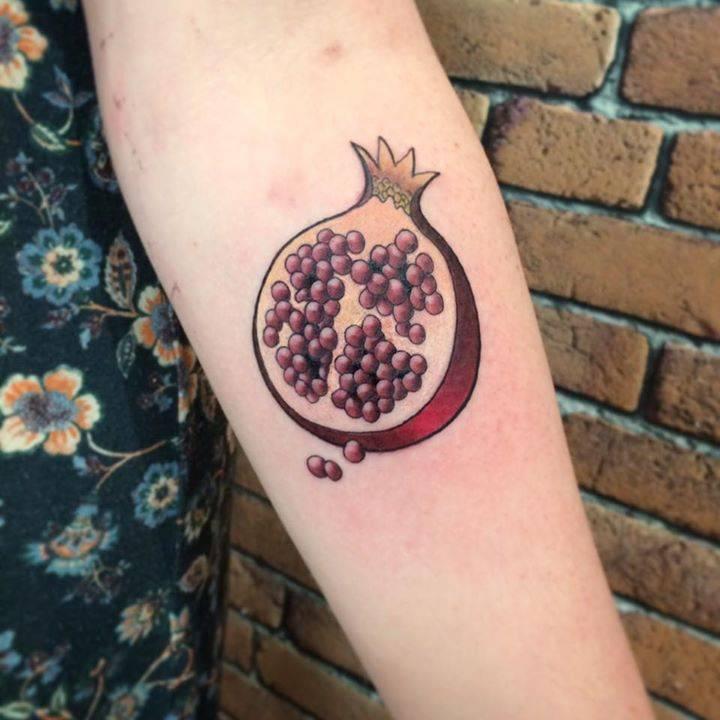 illustrative pomegranate tattoo on the inner forearm. Black Bedroom Furniture Sets. Home Design Ideas