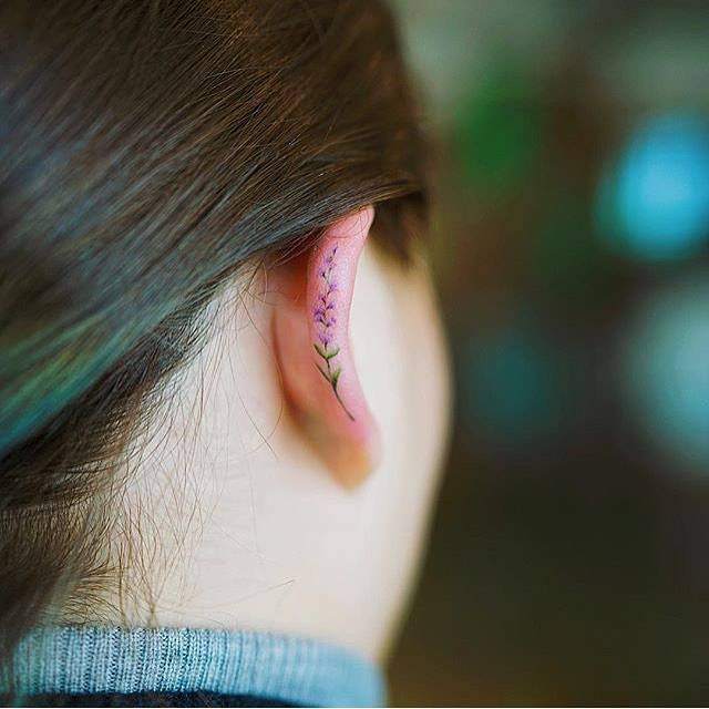Flower tattoo on the ear.
