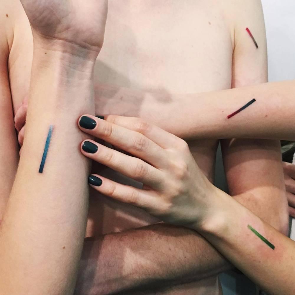 Matching minimalistic line gradient tattoos.