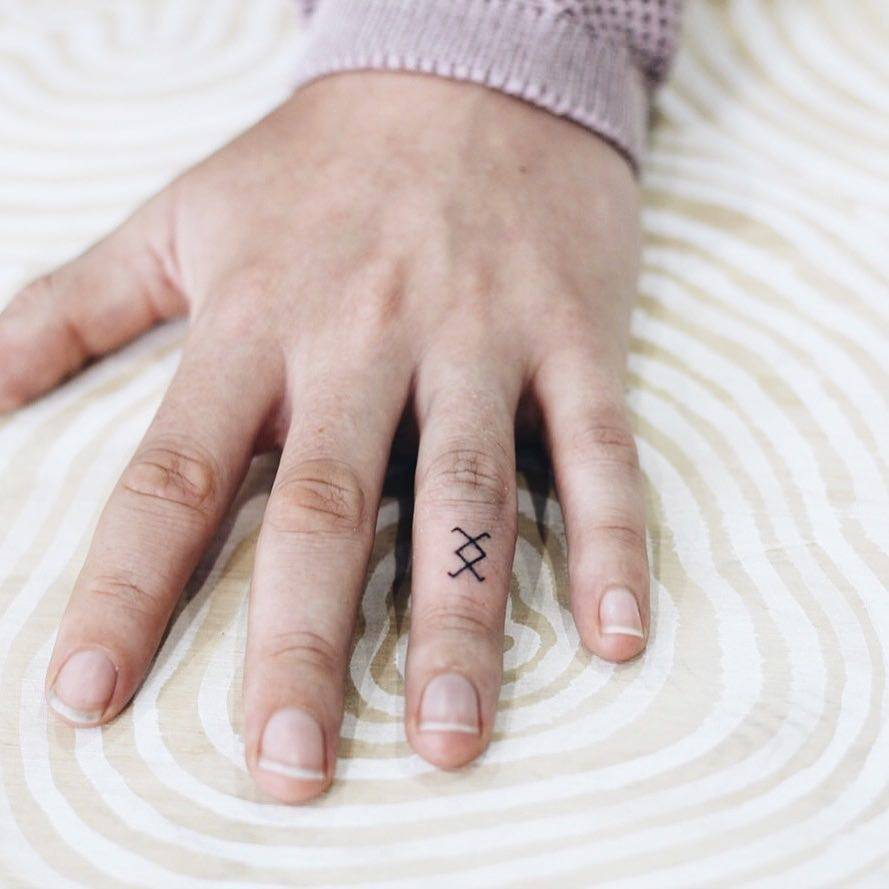 Hand poked ingwaz rune.