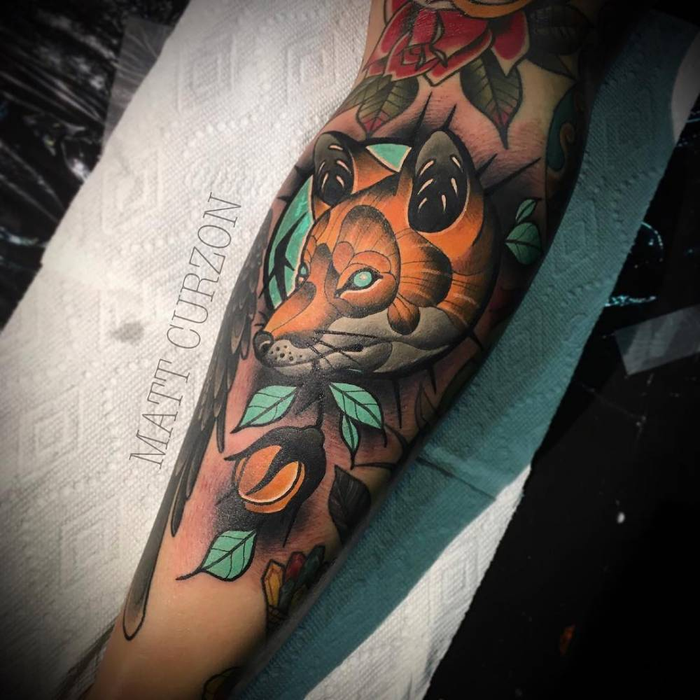 Neotraditional fox tattoo on the right calf.