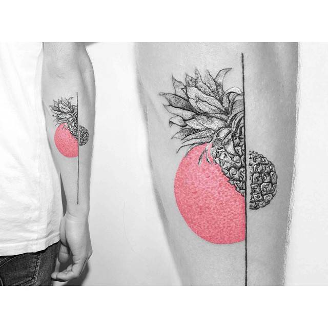 Graphic pineapple tattoo on the right forearm.