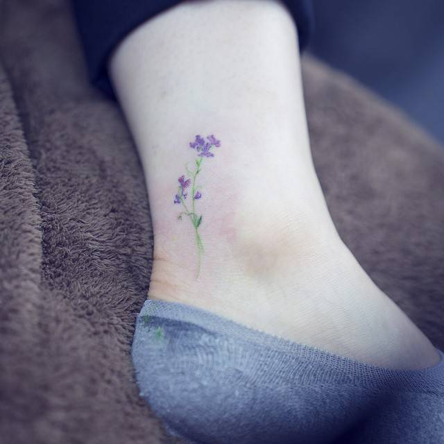 15 of the smallest most tasteful flower tattoos. Black Bedroom Furniture Sets. Home Design Ideas