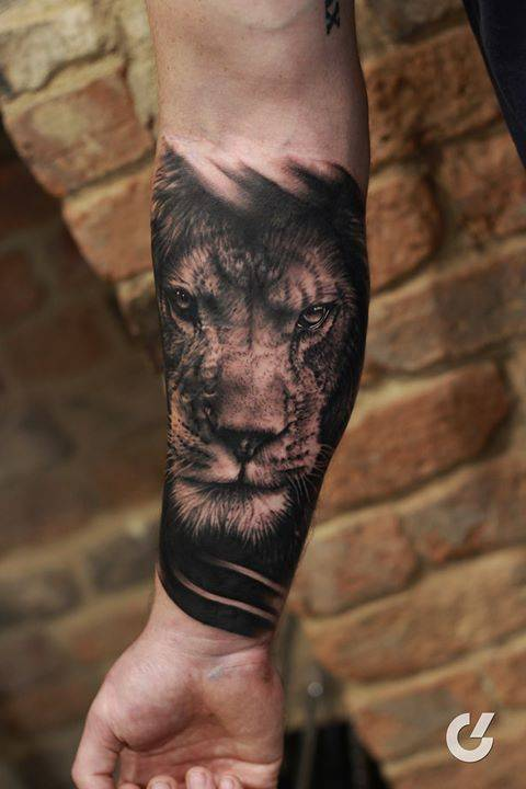 b11cce863 Black and grey lion head tattoo on the right inner