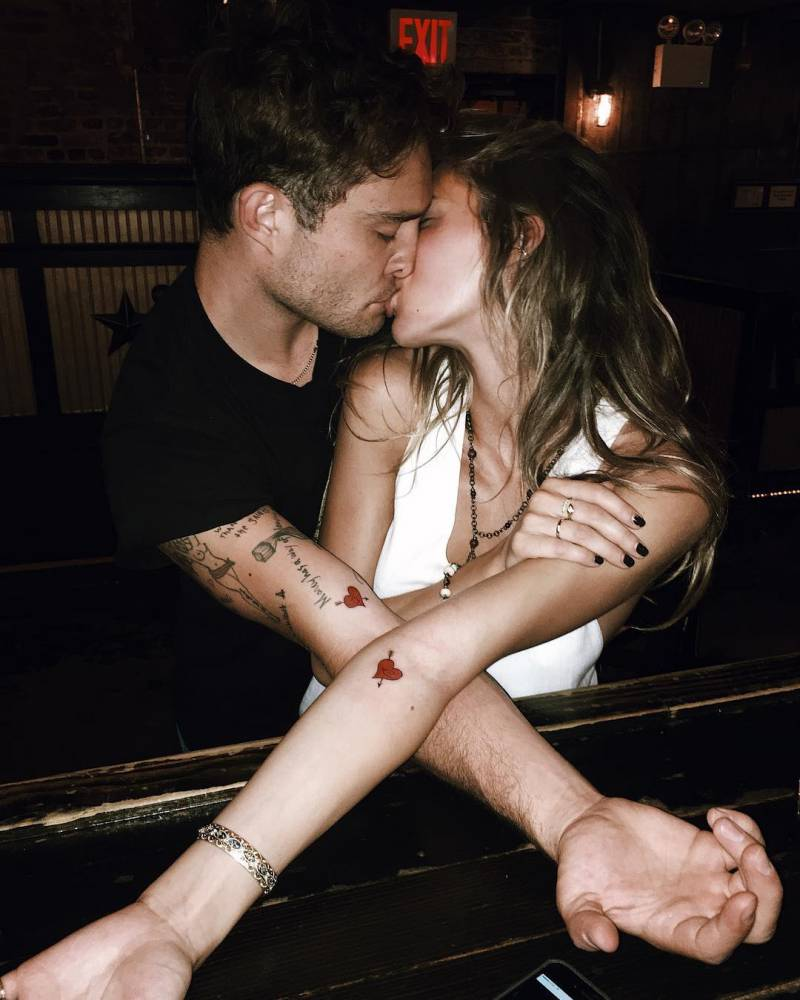 Ed Westwick and Jessica Michél Serfaty's matching heart and arrow tattoos.