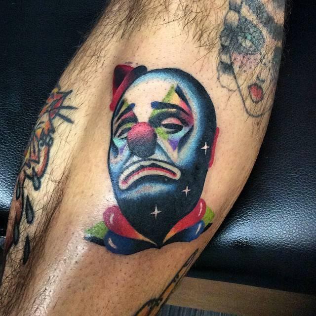 Sad Clown Tattoo On The Left Shin