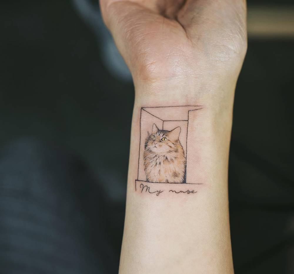 small cat inside a box tattoo on the right inner wrist. Black Bedroom Furniture Sets. Home Design Ideas