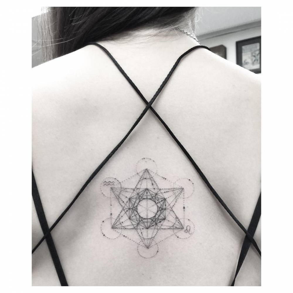 Single needle Metraton cube tattoo on the back.