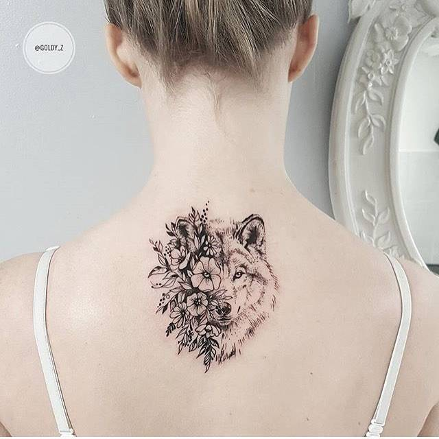 Flower wolf tattoo on the upper back.