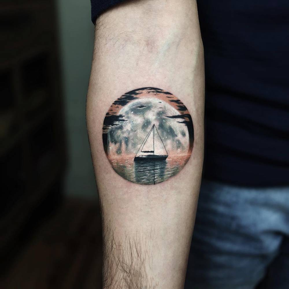 Sailboat tattoo on the right inner forearm.