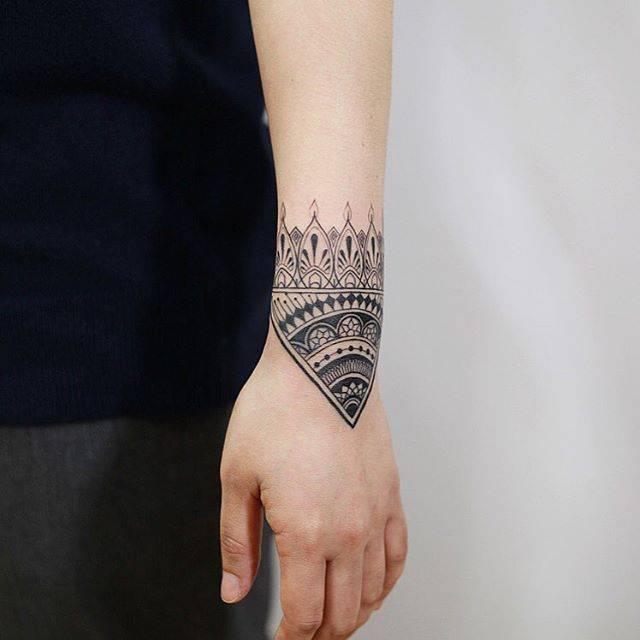 Ornamental Bracelet Tattoo On The Left Wrist Tattoo: Ornamental Bracelet On The Left Wristband