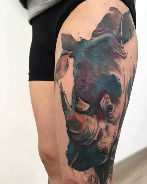 Watercolor rhino tattoo.