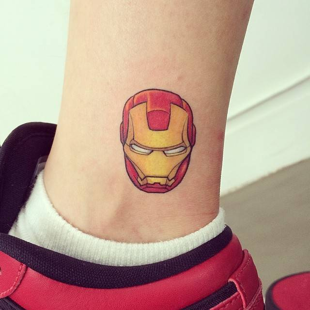 Ironman mask tattoo on the ankle.