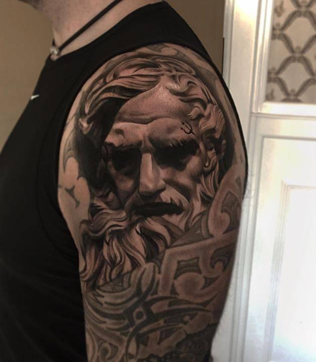 Black And Grey Poseidon Tattoo On The Left Upper Arm