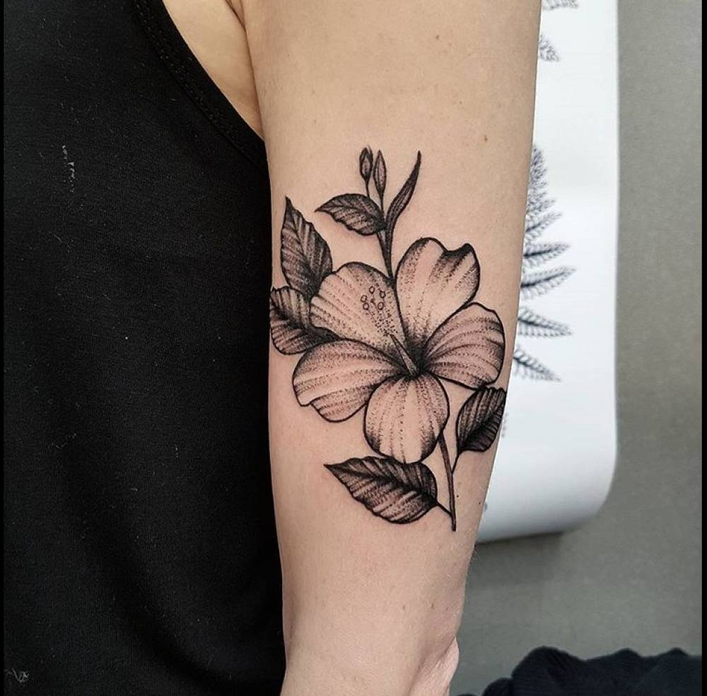 Hibiscus Flower Tattoo On The Left Upper Arm