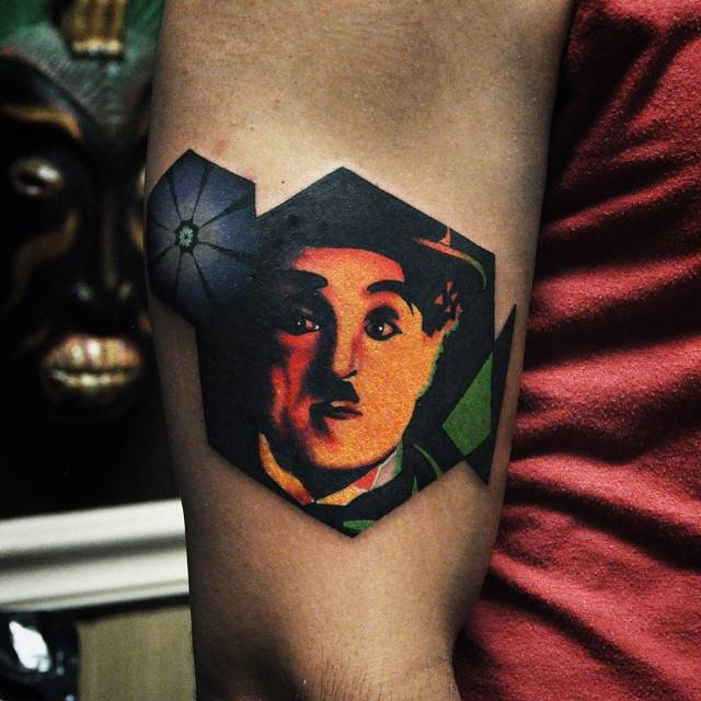 charlie chaplin portrait tattoo on the right upper arm. Black Bedroom Furniture Sets. Home Design Ideas