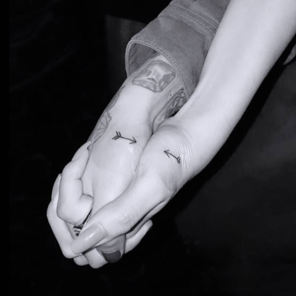 Matching arrow tattoos on Julia Michaels (done by London Reese) and Selena Gomez (tattooed by Brad Reis).