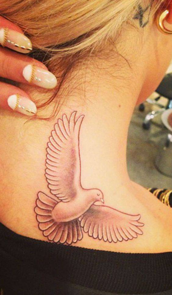 Rita Ora got a dove tattoo on the back of her neck/shoulder area in May 2013.