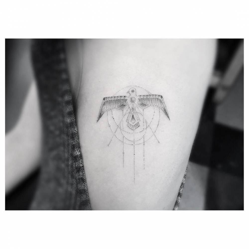 Single needle thunderbird tattoo on the left side ribcage.