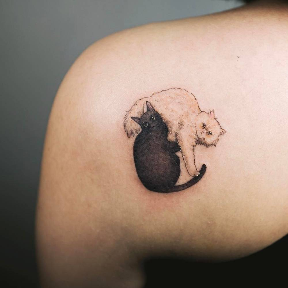 Black and white cat couple tattoo on the left shoulder for Cat asshole tattoo