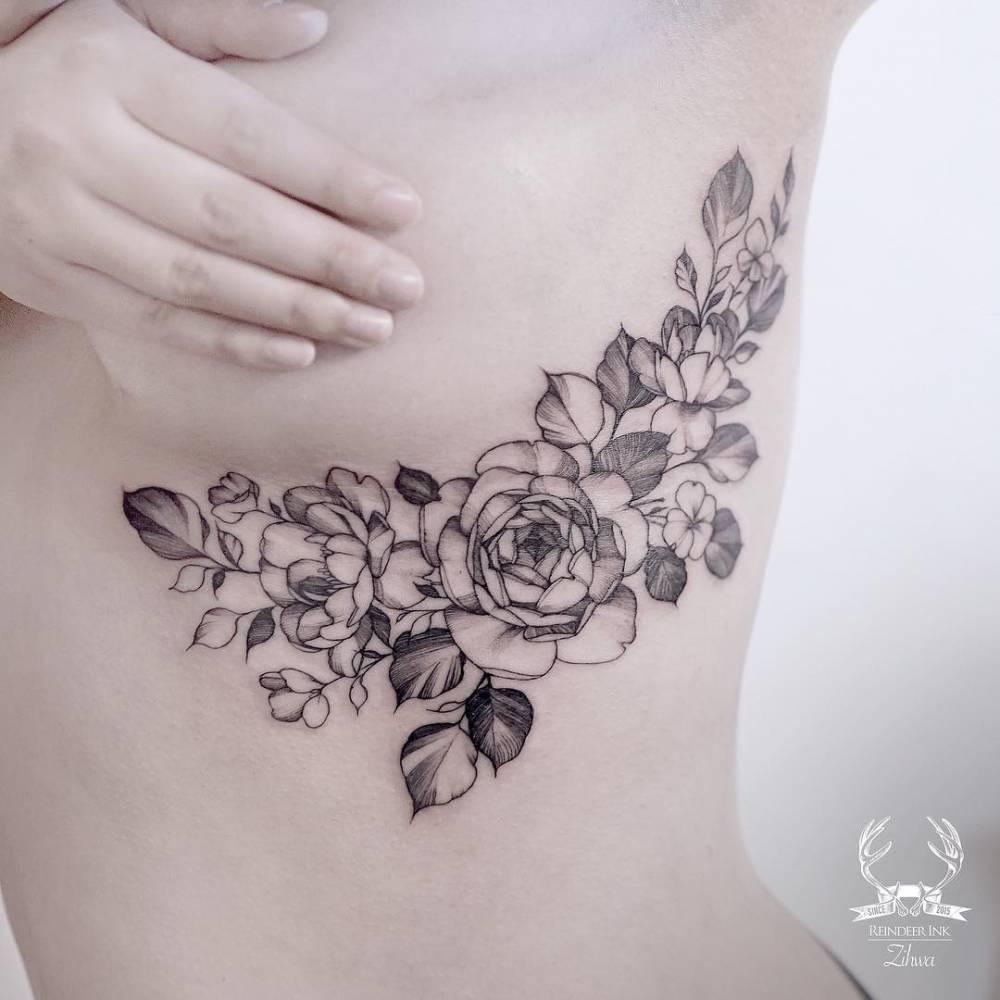 Side breast flower wreath tattoo for Side boob tattoo ideas