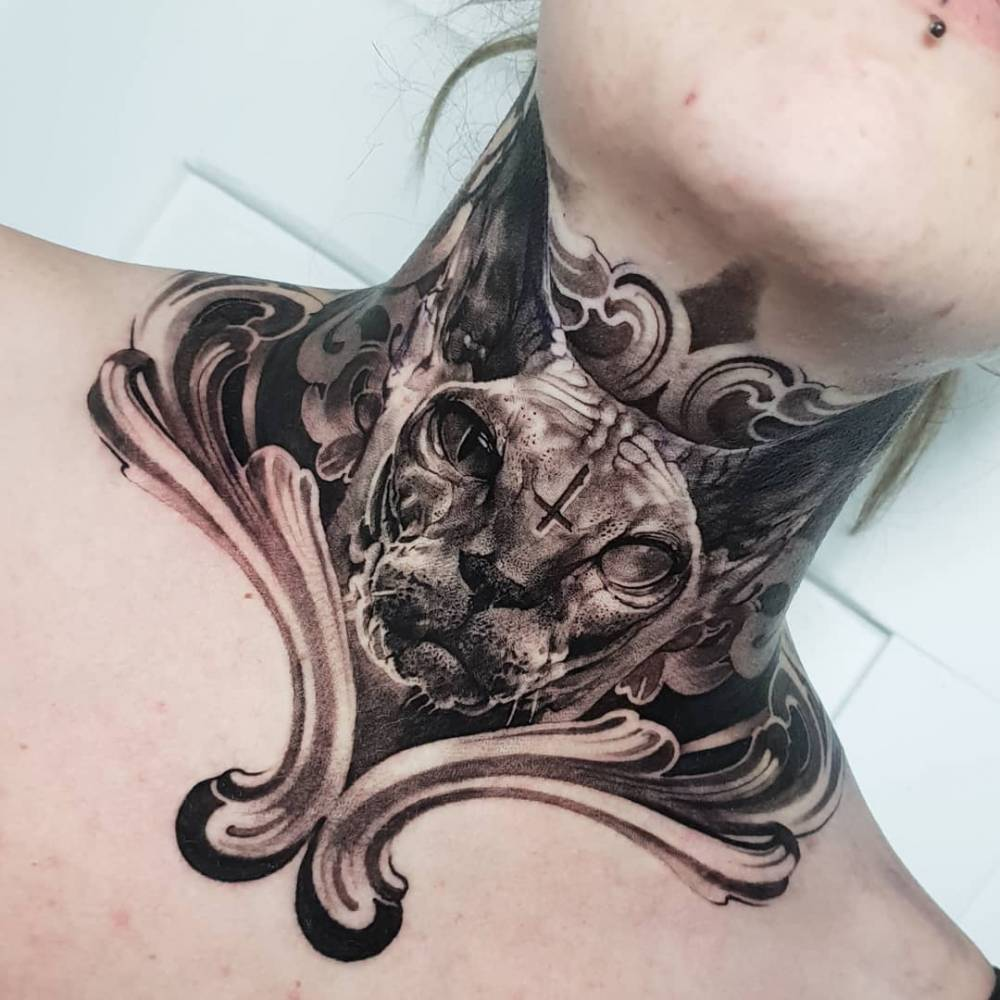 Sphynx tattoo on the neck.