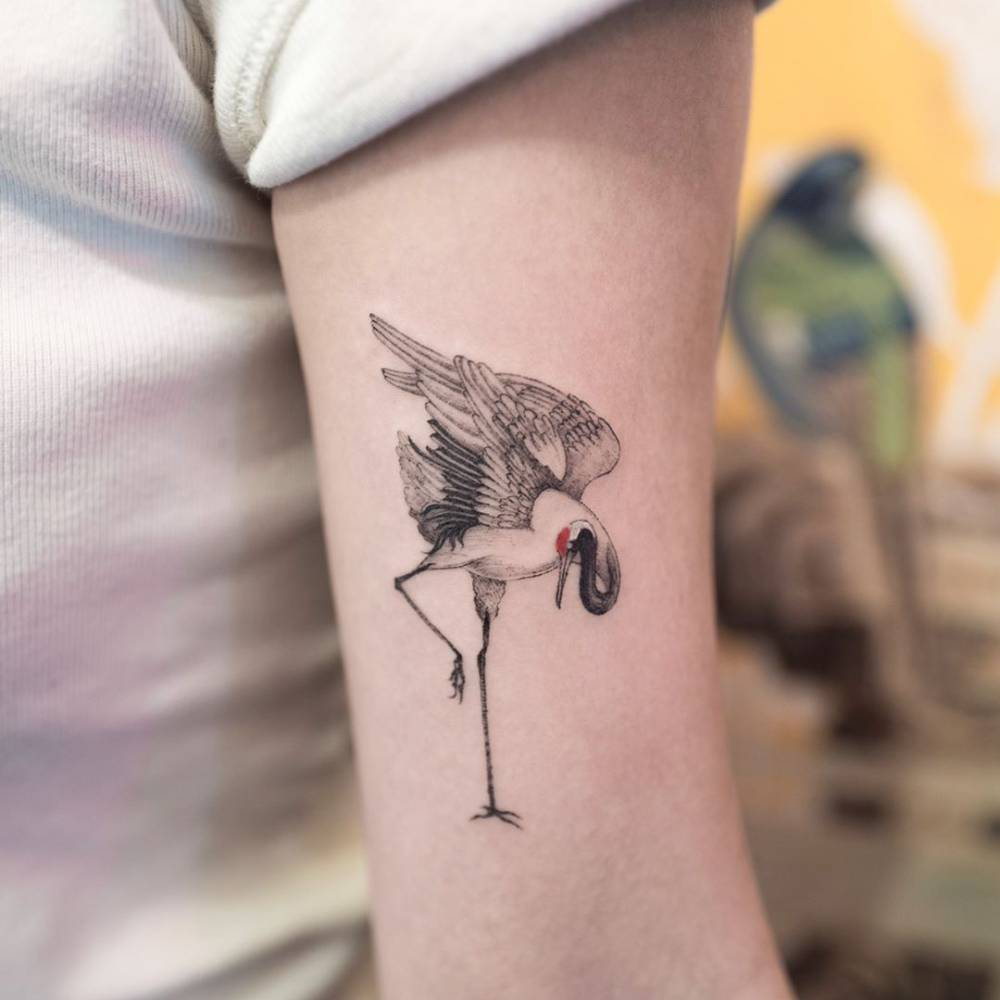 Red Crowned Crane Tattoo On The Left Bicep