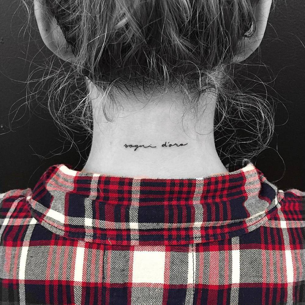 Back Of The Neck Tattoo Saying Sogni Doro