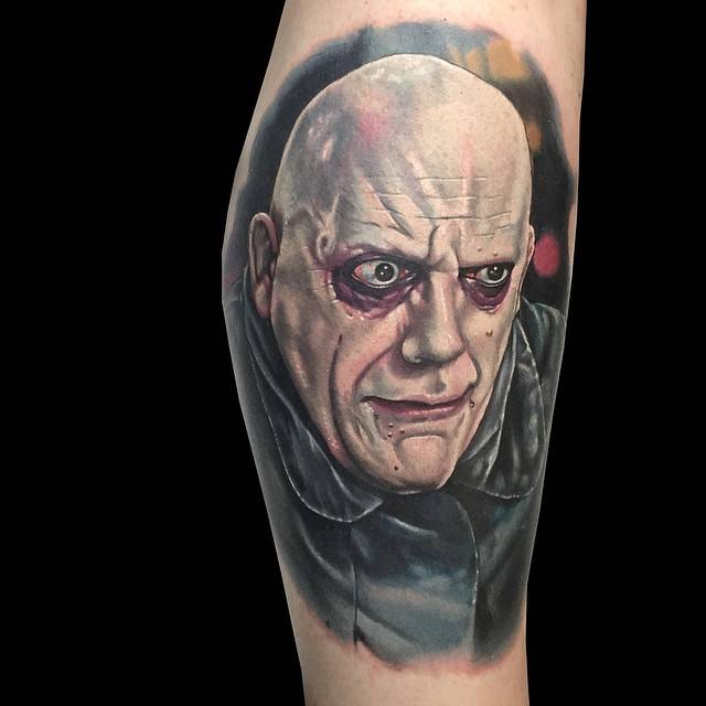 Uncle Fester portrait tattoo on the calf.