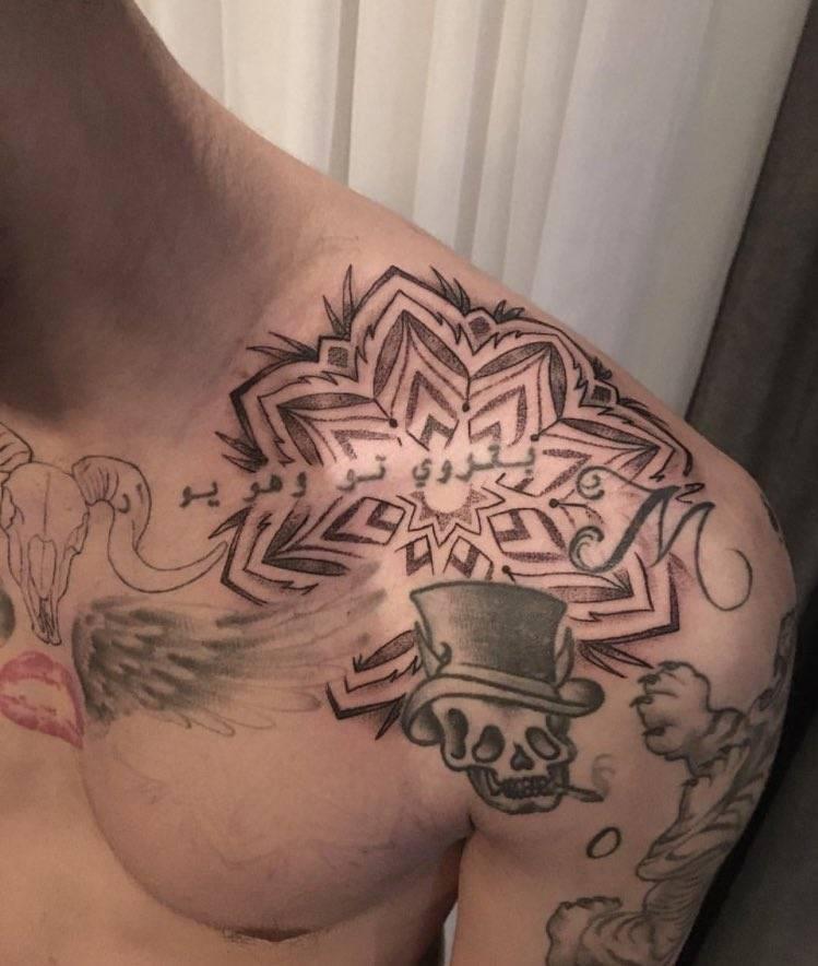 Large mandala design on Zayn Malik's left shoulder.